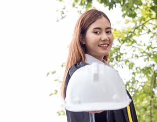 student graduate in garden