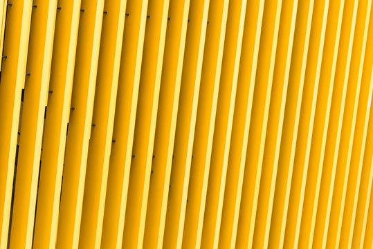 Detail of yellow metal building facade