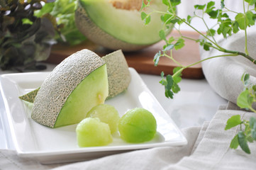 Pieces of Fresh Green Melon Serve on White Plate