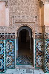 A small door of Medersa Ben Youssef (Koran school), with decorated wall tiles, Marrakech, Morocco