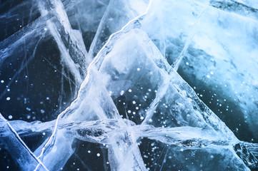 Ice on the frozen lake. Macro image, selective focus