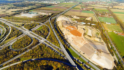 Aerial View Of Highway Junction And Gravel Quarry