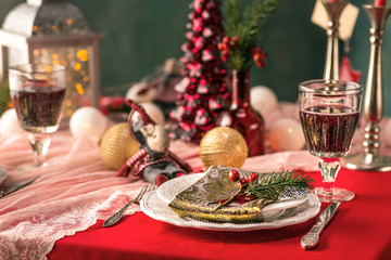Beautiful Christmas table setting with decorations