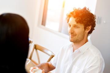 Man having tea at home