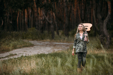 Pretty woman guitar nature fashion look concept. Unity with nature. Music in heart.