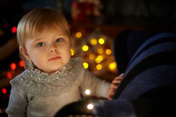 Sweet girl in Christmas tree