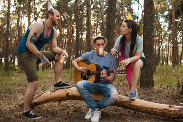 Friends guitar song picnic party nature concept. Traveler lifestyle. Hiking happy moments.
