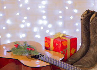 music christmas background with guitar and cowboy shoes