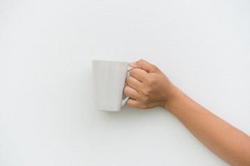 White coffee cup in hand on white background