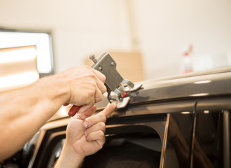Repairing dents in a car