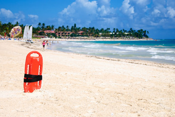Red plastic buoy for a lifeguard ready to save people on beach