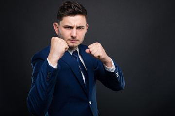 Mad businessman beeing ready for fight