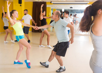People practicing vigorous lindy hop