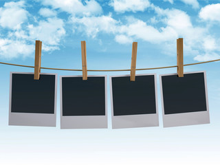 Photographs hanging on a clothesline