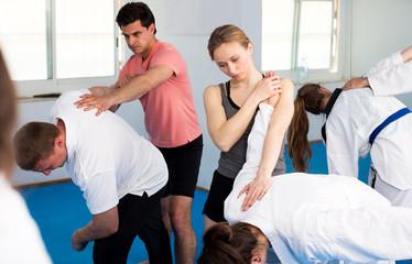 Adults training in pairs at taekwondo class