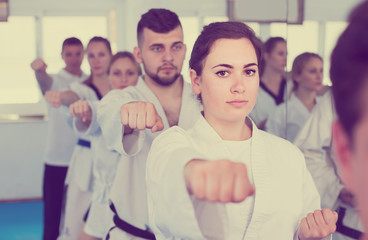 trainees expressing interest in attending karate class