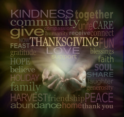 Share your Love at Thanksgiving - male cupped hands surrounded by a muted colour THANKSGIVING word cloud on a dark background with a light emerging from hands