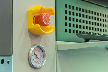 Emergency stop button and vacuum gage