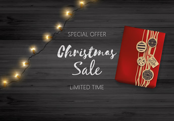 Christmas Sale Design. Lettering on Black Wooden Board with Giftbox and Christmas Decoration.