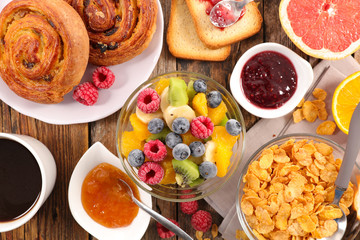 breakfast with fruit,croissant,cereal and coffee