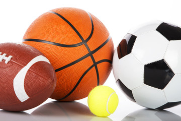 Assorted sports balls on white background