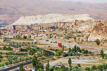 Turkish flag on the mountain in Cappadocia valley in Goreme national park