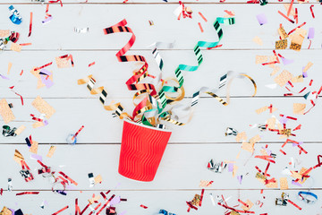 confetti spilling out of paper cup