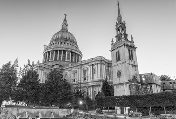 LONDON - JUNE 29, 2015: Tourists visit St Paul Cathedral at night. The city attracts 30 million people every year
