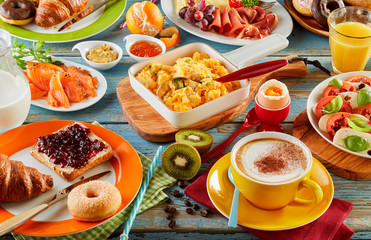 Large tasty breakfast spread on a table