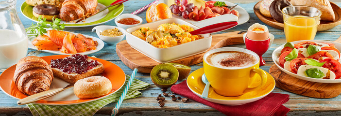 Colorful breakfast spread in a panoramic banner