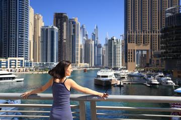 Girl in marina bay district in Dubai
