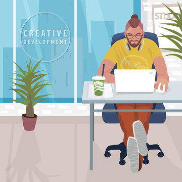 Young fashionable designer or hipster manager sitting at table and working on white laptop. Interior of modern office with large windows. Simplistic realistic style