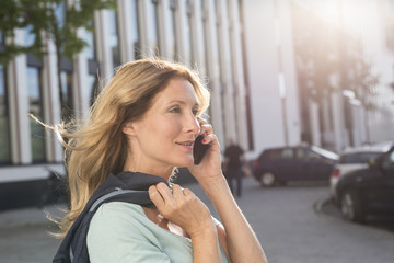Portrait of woman on cell phone in the city