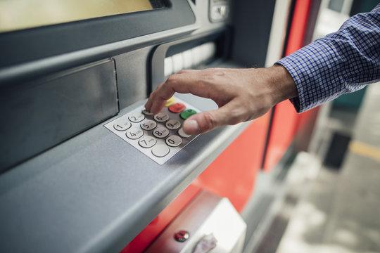 Businessman Using Cash Machine