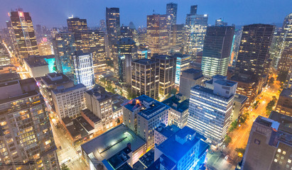 VANCOUVER, CANADA - AUGUST 10, 2017: Building lights of Downtown, aerial view. Vancouver attracts 10 million tourists annually