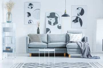 Monochromatic lobby with gray couch
