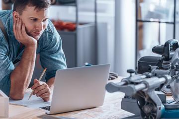 Handyman working using laptop