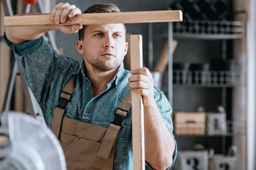 Concentrated carpenter matching wooden parts