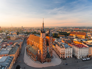 Fototapeta Krakow Market Square from above, aerial view of old city center view in Krakow at morning time, main square, famous cathedral in sun light obraz