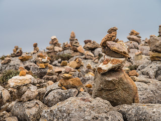 Grouping stones as a symbol of knowledge and desire to return.