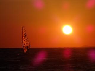 Sailing at sunset orange sky