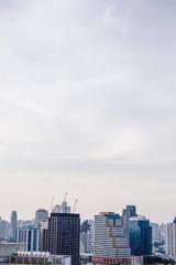 city buildings with blue sky