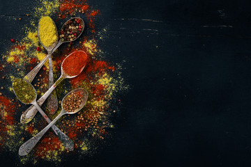 Printed kitchen splashbacks Spices Spices and herbs. A large assortment of spices. Indian cuisine. On the wooden table. Top view. Free space for text.