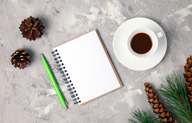 New Year's composition with notebook and cup of coffee. Space for text. New year resolution concepts. Planning of the new year. Top view