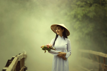 Beautiful woman in Ao Dai  traditional dress of Vietnam.