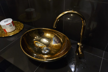 copper sink in a cafe in the toilet
