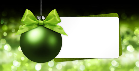 Fotomurales - greeting gift card with green christmas ball on blurred lights background white template copy space