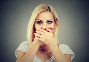 woman covering her mouth with hands scared to speak out about abuse