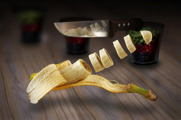 levitating sliced banana with knife