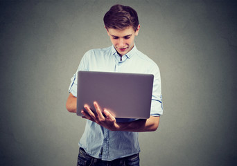 Young man using his laptop computer